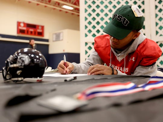 Bishop Mitchell signs to play football with Portland State University at Kennedy High School in Mt. Angel on Wednesday, Feb. 1, 2017.
