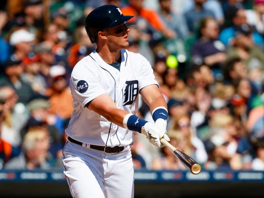 Apr 8, 2017; Detroit, MI, USA; Tigers catcher James McCann hits a home run in the fifth inning against the Red Sox at Comerica Park.