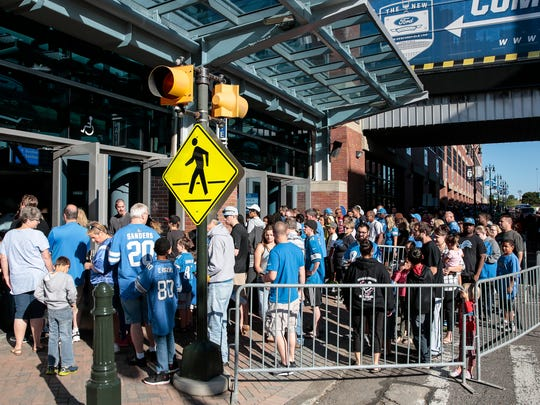 Lions fans line up outside Ford Field to attend Family Day, Saturday, Aug. 5, 2017 in Detroit.