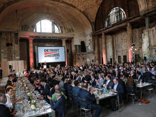 Invitees sit down to eat inside the  Michigan Central
