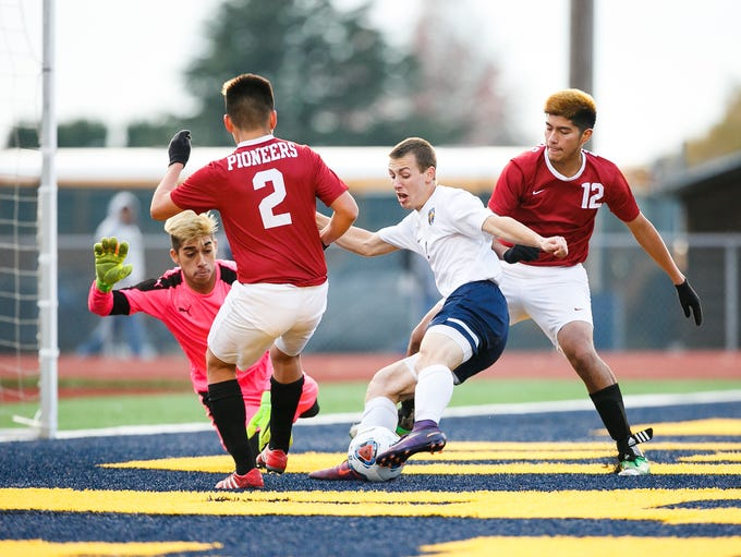 Stayton's Jacobe Croff (12) tries to score a goal in
