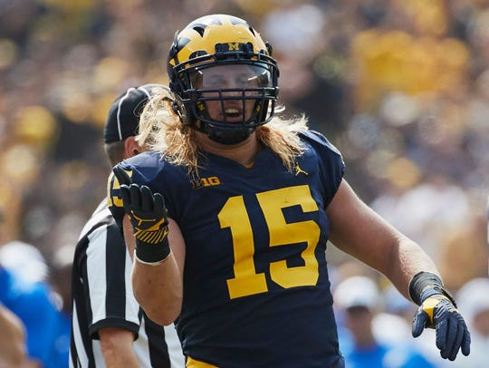 Michigan defensive end Chase Winovich celebrates a