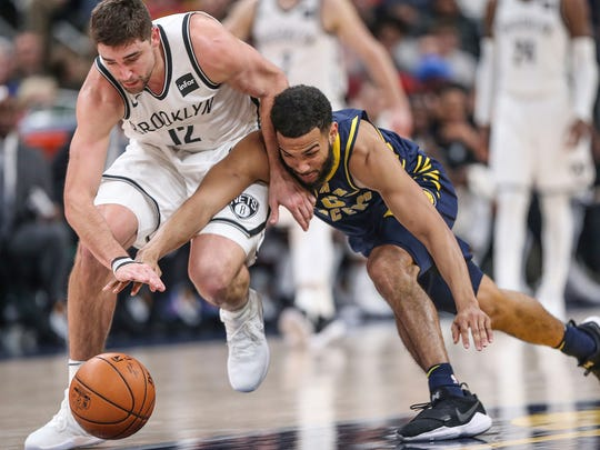 Brooklyn Nets guard Joe Harris (12) and Indiana Pacers guard Cory Joseph (6) goes after the ball during fourth quarter action between the Indiana Pacers and Brooklyn Nets at Banker's Life Fieldhouse, Indianapolis, Saturday, Dec. 23, 2017. The Pacers won in overtime, 123-119.