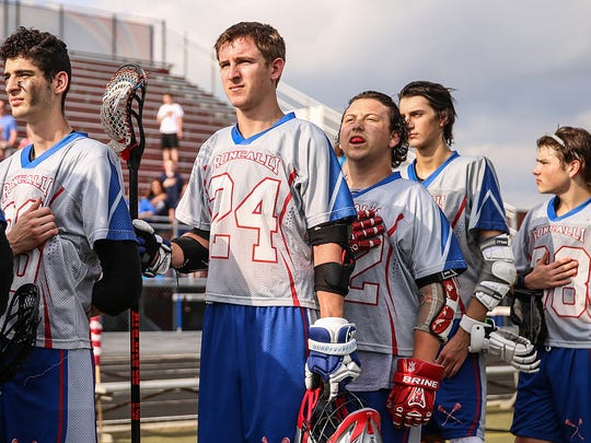 Center, Vinny Romano (52) stands for the national anthem before a home game against Park Tudor.