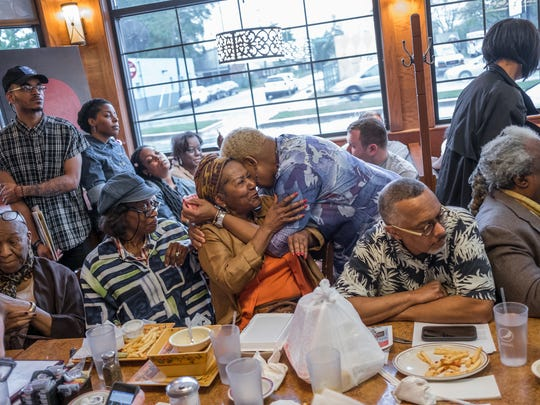 People sit cramped in the dining room while listening to other artists present their work during the Detroit Fine Art Breakfast Club at Noni's Sherwood Grille in Detroit on Monday, May 21, 2018. The meeting helps up-and-coming artists and community members connect with buyers and gallery members during the weekly event.