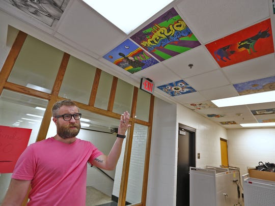 Producer Ed Timpe walks through the Broad Ripple High