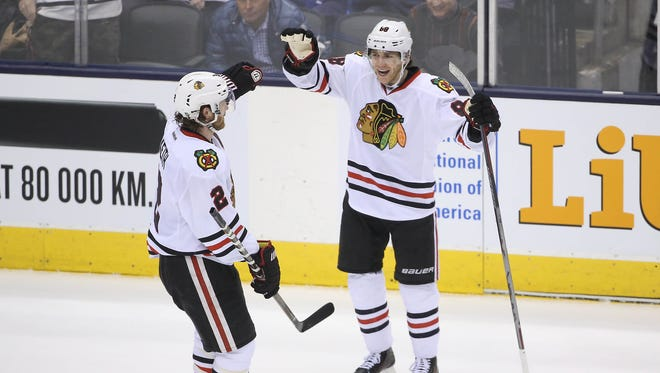 Chicago Blackhawks right wing Patrick Kane (88) celebrates his second goal of the game with defenseman Duncan Keith (2) in the second period against the  Toronto Maple Leafs at Air Canada Centre.