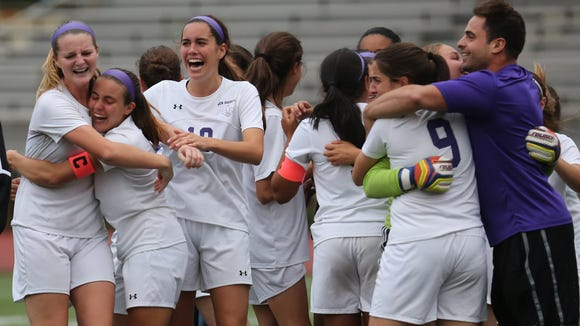 New Rochelle celebrates their  4-3, win over Scarsdale in penalty kicks during Class AA quarterfinals at New Rochelle High School Oct. 25, 2017.