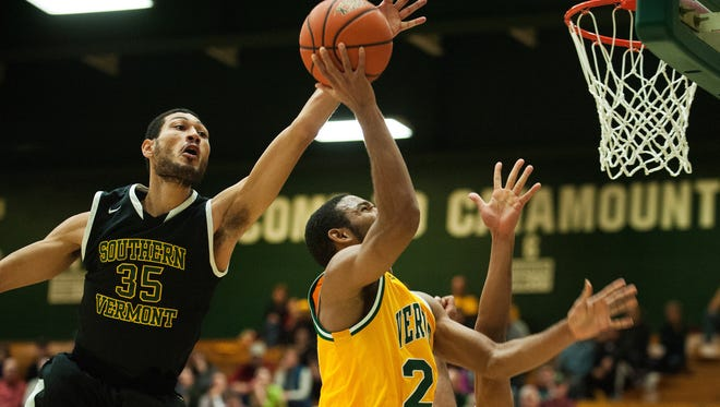 South Vermont's Casey Hall (35) leaps to block the shot by Vermont's Dre Wills (24) during the men's basketball game Wednesday night.