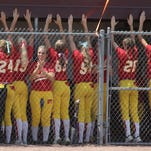 Carlisle players pound out a beat on the dugout roof to get the crowd fired up at the start of the game against Oskaloosa. Carlisle lost 6-5 to Oskaloosa in the Class 4A championship game July 22 at the state tournament in Fort Dodge.