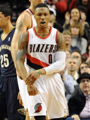 Damian Lillard celebrates a fourth-quarter bucket Saturday against the Pelicans.