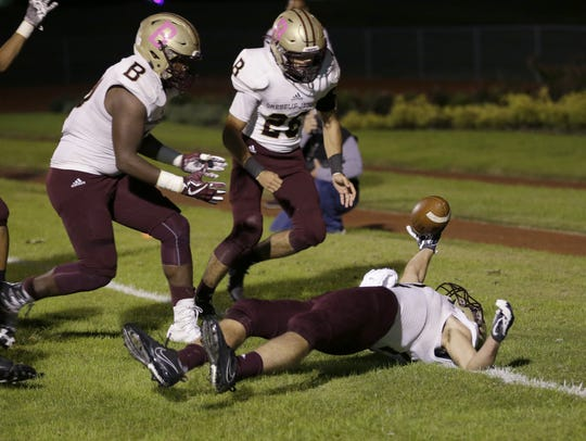 After blocking the punt, Brebeuf Jesuit Braves Jacob
