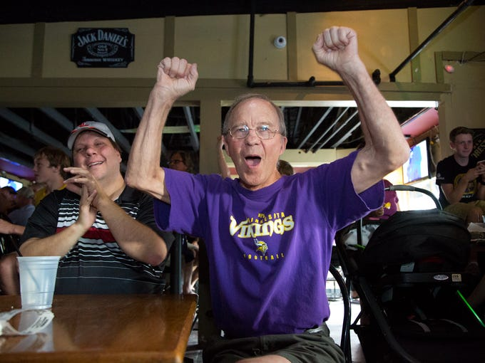 Fritz Esser, right, and son, Josh Esser, cheer for the Vikings at Gerstle's Place bar. September 28, 2014.