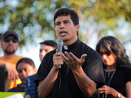 Father Javier Gonzales, from the archdiocese of San Bernardino speaks at a pro-immigrant vigil in Murrieta