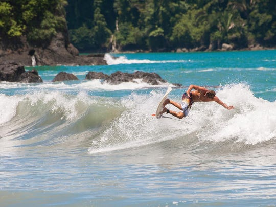 Surfers at the Kalon Surf School in Dominical, Osa Penisnsula, Costa Rica, learn to surf amidst the majestic beauty of the country's stunning jungle-bordered beaches. Currently, beaches are open only from 5 a.m. to 8 a.m.