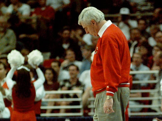 A dejected looking Indiana coach Bobby Knight stands alone along the sidelines at the end of Indiana's 54-51 loss to Boston College March 15, 1996.
