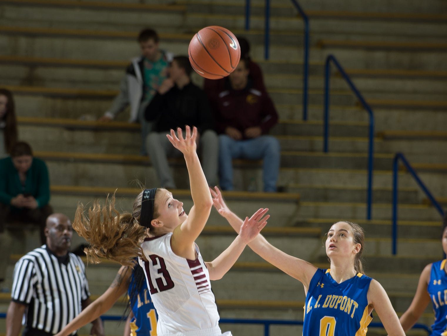 Caravel's Grace Lange (13) reaches for the ball in the quarterfinals of DIAA Girls Basketball Tournament at the University of Delaware against A.I. duPont.