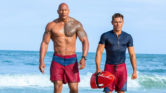 Dwayne Johnson, left, and Zac Efron might take your