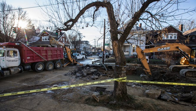 The scene at the intersection of Oak and Clay Streets where repair work has begun on a water main break. Dec. 13, 2017