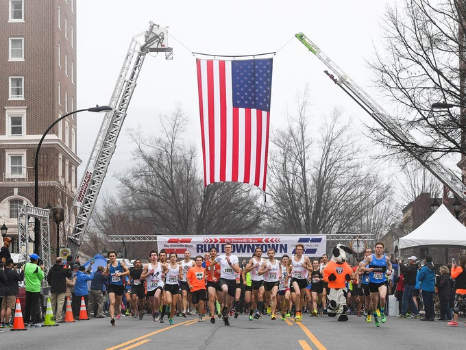 Runners start the 38th annual Greenville News Run Downtown