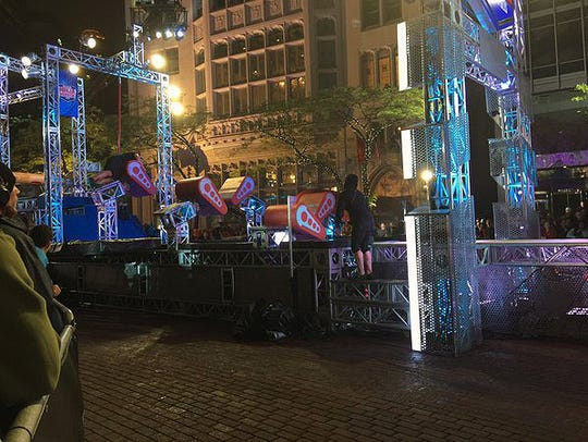 Ninjas watch from behind the barricade under blankets