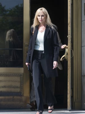 Karen Sypher, charged with trying to extort Louisville men's basketball coach Rick Pitino and of lying to the FBI, leaves the Gene Snyder Courthouse following a court appearance Friday, April 24, 2009, in Louisville, Ky.,  Sypher did not enter a plea in the case and was released on her own recognizance.