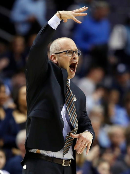 FILE - In this March 9, 2018, file photo, Rhode Island head coach Dan Hurley reacts during the first half of an NCAA college basketball quarterfinal game against VCU, in the Atlantic 10 Conference tournament in Washington. Rhode Island head basketball coach Dan Hurley has agreed to become the head coach at the University of Connecticut. Hurley replaces Kevin Ollie, who was fired earlier this month. UConn made the announcement Thursday morning, March 22, 2018, in a Tweet.(AP Photo/Alex Brandon, File)