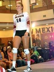 Aggie Volleyball player Megan Mattie shows off the UA White game day home uniform.