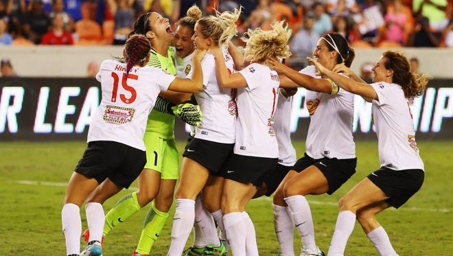 Goalkeeper Sabrina D'Angelo celebrates with her Western New York Flash teammates after defeating the Washington Spirit in a shootout to win the NWSL title.