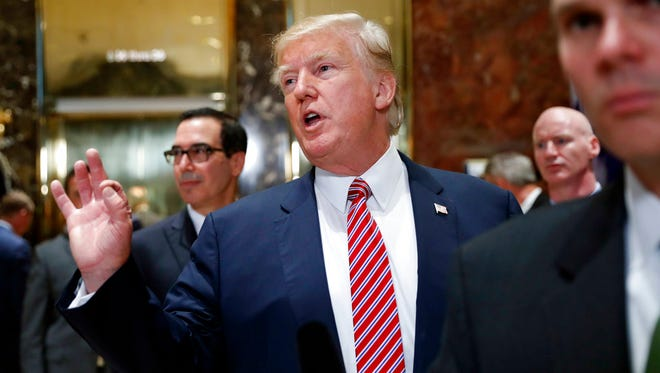 President Donald Trump gestures as he answers reporters questions in the lobby of Trump Tower, Tuesday, Aug. 15, 2017 in New York. (AP Photo/Pablo Martinez Monsivais)