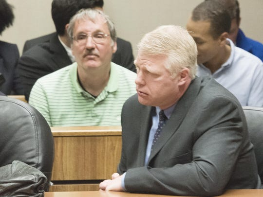 Michael Prysby, Michigan Department of Environmental Quality District 8 Water Engineer, left, and Stephen Busch, Michigan DEQ District 8 Water Supervisor, appear in court in this April 20, 2016 file photo. Prysby, Busch and three other state bureaucrats can reclaim their state jobs after prosecutors dropped charges against them but retained the ability to refile the charges.