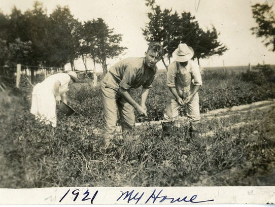 Hog Islanders work the land in a 1921 photograph. The