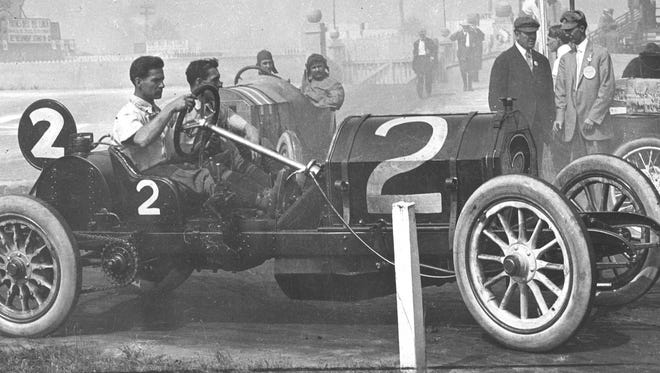 Ralph DePalma heads to the garage after a practice run prior to the 1911 Indianapolis 500.