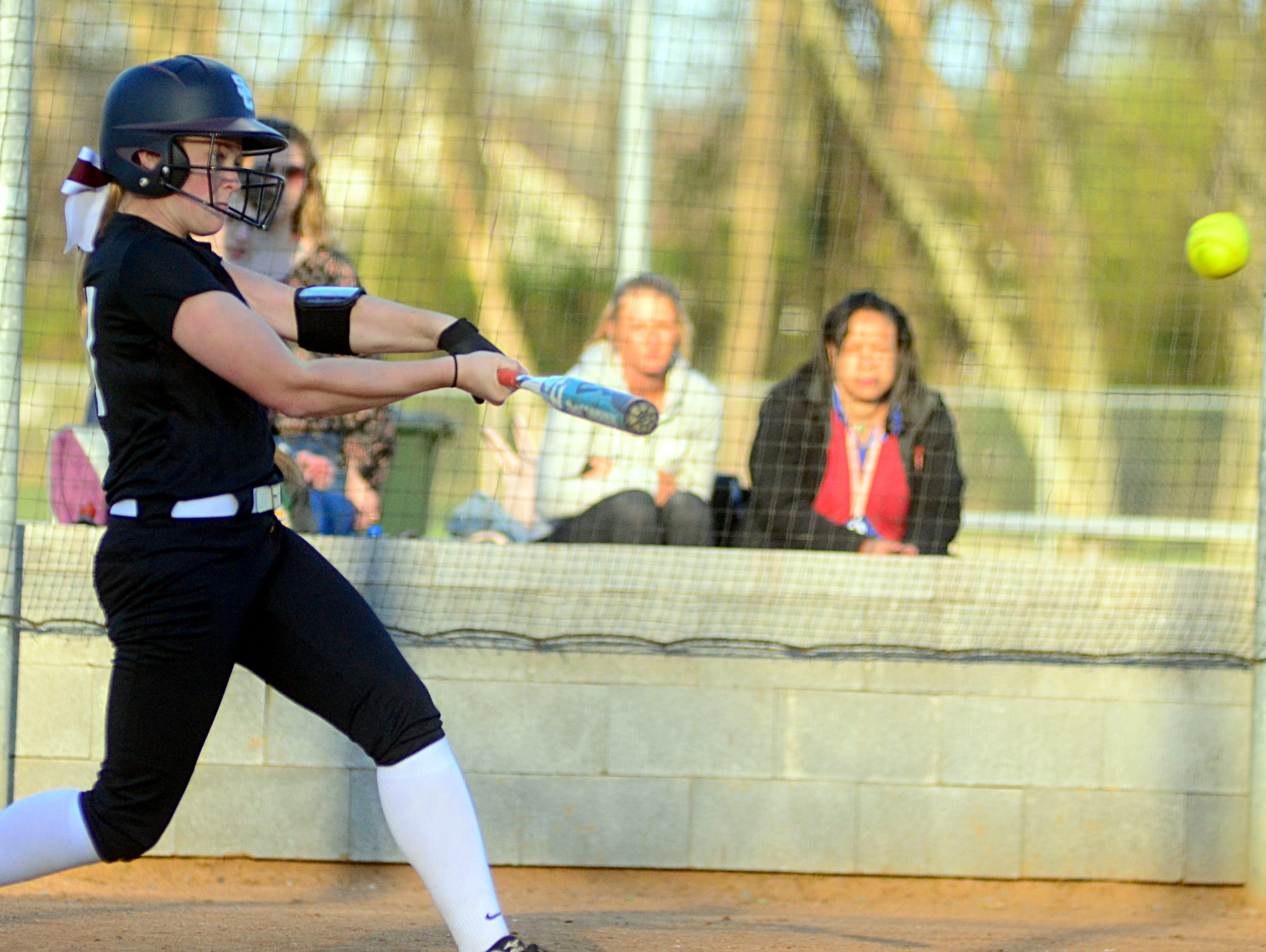 Station Camp High freshman Kyndal Chaffin hits a fourth-inning triple during Station Camp's 12-4 victory at Gallatin on Monday evening.