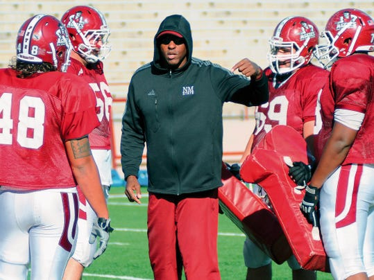 Robin Zielinski   Sun-News   New Mexico State University defensive line coach Kerry Locklin works with his players on Wednesday at Aggie Memorial Stadium.
