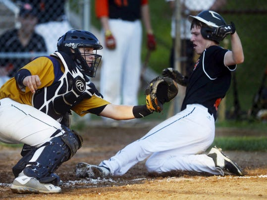 Suburban York's Dan Dellinger slides into home but is tagged out by Hanover catcher Isaac Silver during an American Legion baseball game Wednesday at York Suburban High School. Suburban York won, 1-0.
