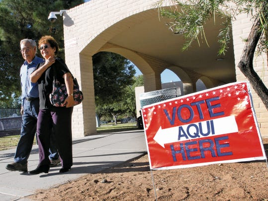 VICTOR CALZADA-EL PASO TIMES Francisco and Victoria Valadez walk out of the Carolina Recreation Center after casting their early vote Thursday.