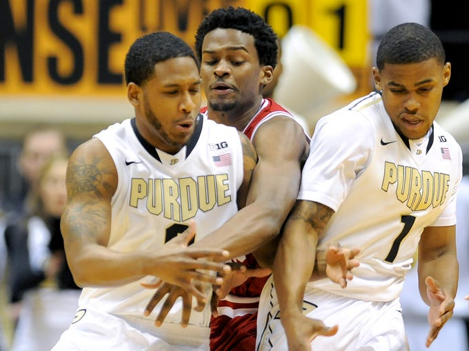 Indiana guard Stanford Robinson knocks the ball away from Purdue guard Terone Johnson (0) and guard Sterling Carter (1) inside Mackey Arena, Saturday, February 15, 2014, in West Lafayette.