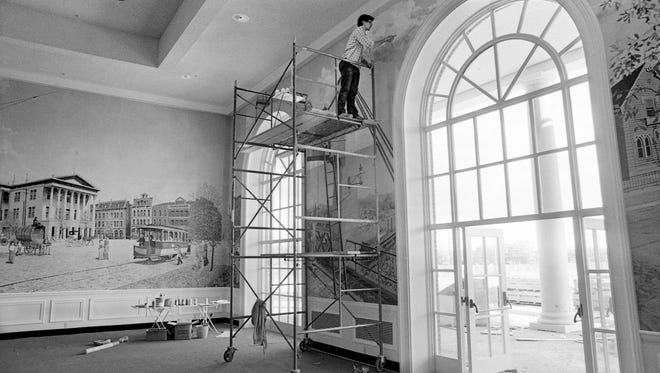 In October 1977, Tom Douglas, a sophomore art student at Austin Peay State University, assists his art teacher, Max Hochstetler, by putting some finishing touches on a huge wall-sized mural painting inside the soon-to-open Opryland Hotel.