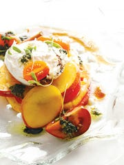 The heirloom tomato salad came with peach slices and a wonderfully rich balsamic dressing.