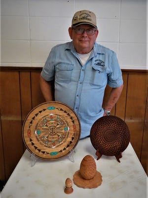 Curtis Shirkey is shown with some of his chip carvings. Shirkey is the latest featured carver from the North Arkansas Woodcarver Club. Shirkey has been a member for 13 years. He has carved various styles of woodcarving and for the past 18months, has carved a style known as Chip Carving and winning ribbon awards at judged woodcarving shows. Lately, Skirkey has been concentrating on South West Native American Patterns for carvers. This involves precise measuring of the wood andtransferring the pattern onto the wood. Then, chip carving follows and finishesthe wood into a work of art. The North Arkansas Woodcarvers Club meetsThursdays mornings at the VFW Post 3246, located at 214 West 7th Street, Mountain Home.