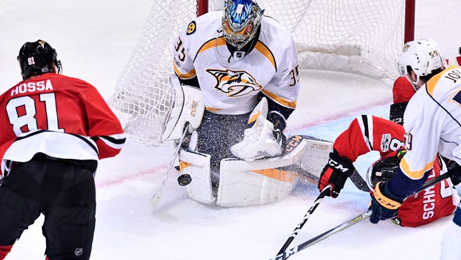 Nashville Predators goalie Pekka Rinne (35) defends the net against Chicago Blackhawks center Nick Schmaltz (8), right, and right wing Marian Hossa (81) in the third period of game two in the first-round NHL playoff series at the United Center, Saturday, April 15, 2017, in Chicago, Ill.