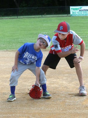 Blue team infielder Ryan Roper gets some fielding advice