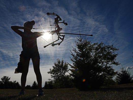 Jessarae Klatt, 13, of Sioux Falls, shoots her bow