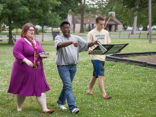 Rebecca Parker, Curtis Rogers and Matt Phillips walk