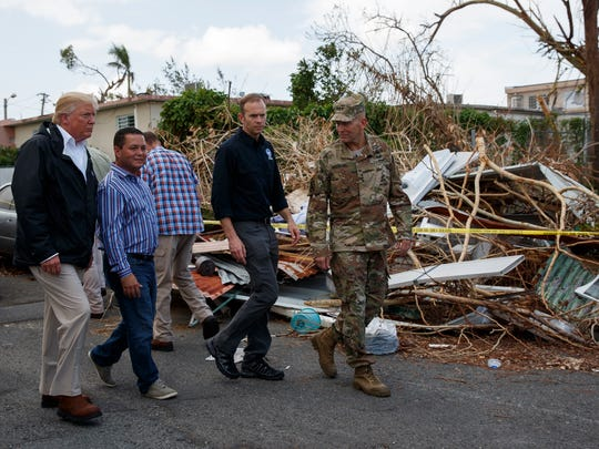 President Donald Trump tours a neighborhood impacted