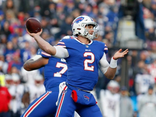Dec 3, 2017; Orchard Park, NY, USA; Buffalo Bills quarterback Nathan Peterman (2) throws a pass during the second half against the New England Patriots at New Era Field. New England beats Buffalo 23 to 3. Mandatory Credit: Timothy T. Ludwig-USA TODAY Sports