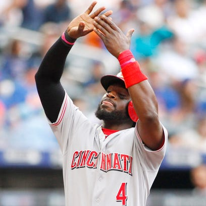 Brandon Phillips celebrates after hitting a solo home run in the first inning of Sunday's game against the Mets.