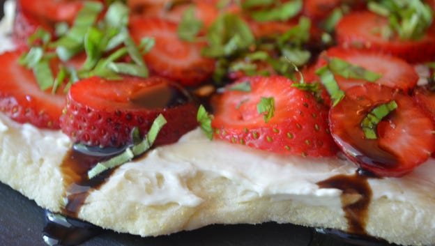 Kiss 2015 goodbye with this Strawberry Basil Dessert Flatbread and pair it with a glass of bubbly or moscato. It's a light dessert and a nice last bite for the year.