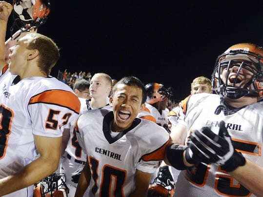Central York players celebrate during the Panthers' 41-6 victory against West York to open the 2013 season last August. The teams' annual season-opening clash is one of the marquee matchups of Week 1, and this year GameTimePA.com is setting up the NewsVroom at the game Friday night at Central York. (Kate Penn -- GameTimePA.com)